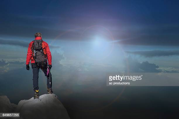 Caucasian hiker standing on mountain top