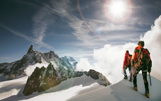 Caucasian hikers standing on snowy mountain top, Mont Blanc, Alps, France - gettyimageskorea