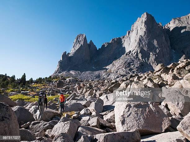 Caucasian hikers walking in rocky field