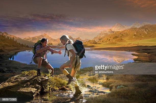 Caucasian hikers walking near remote lake, Lai da Vons, Canton Graubunden, Switzerland