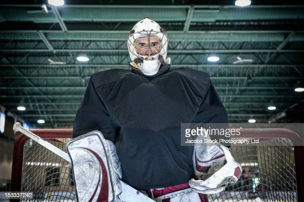 caucasian hockey goalie standing near net - ice hockey player stock pictures, royalty-free photos & images