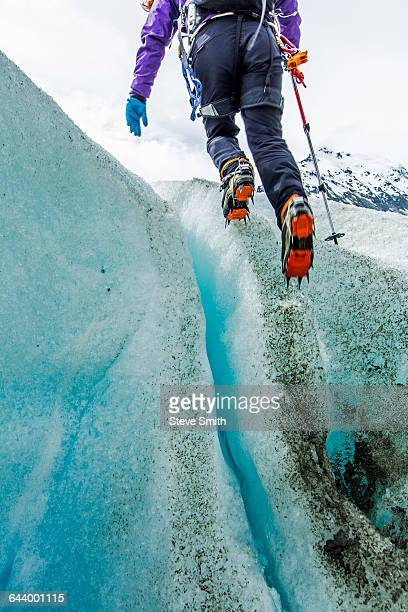 Caucasian ice climber on glacier
