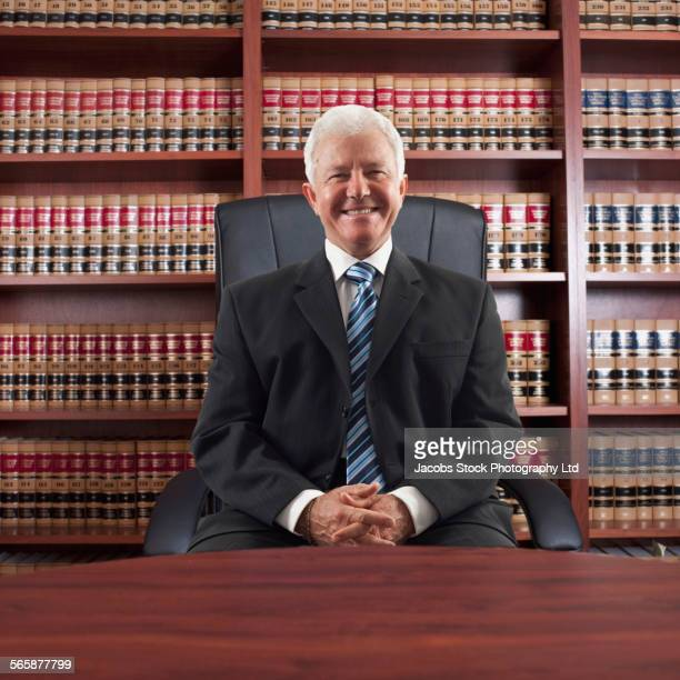 Caucasian lawyer sitting at desk