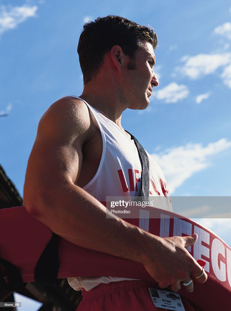 caucasian lifeguard looks out from his station : Foto de stock