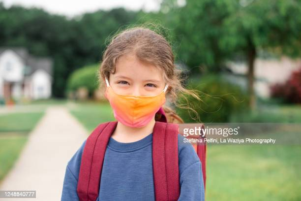 caucasian little girl ready to go to school wearing a face mask - education stock pictures, royalty-free photos & images