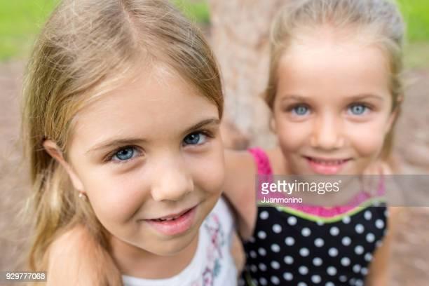 Caucasian little girls posing together