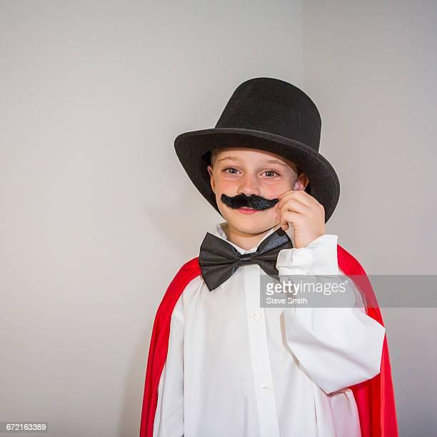 Caucasian magician twirling mustache