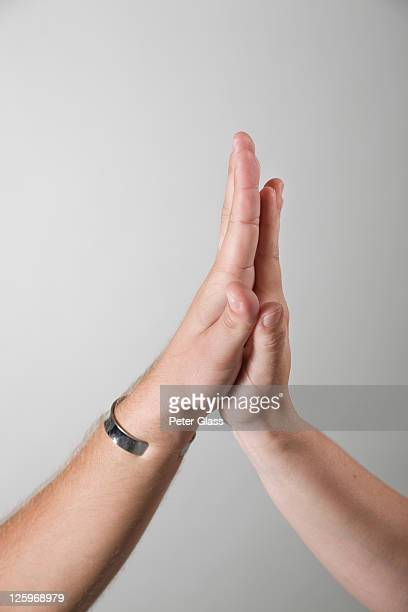 caucasian male and female hands touching - slapping stock pictures, royalty-free photos & images