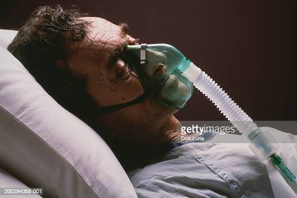 caucasian male patient in hospital - patient on ventilator stock pictures, royalty-free photos & images