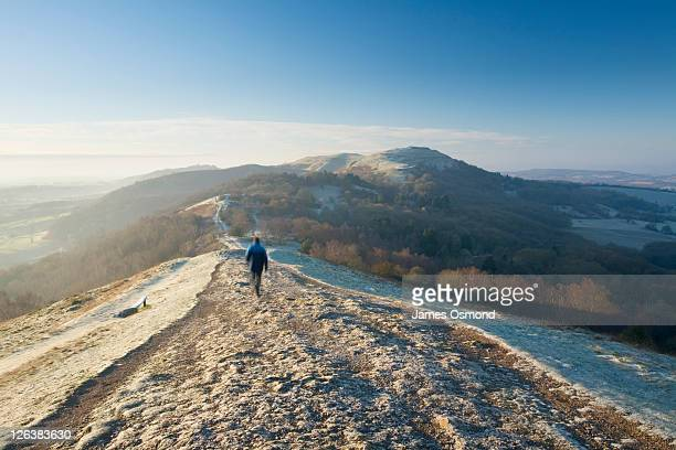 caucasian male walker (29 years old) on the malvern hills on a frosty winter morning. herefordshire & worcestershire. england. uk. - clear sky stock pictures, royalty-free photos & images
