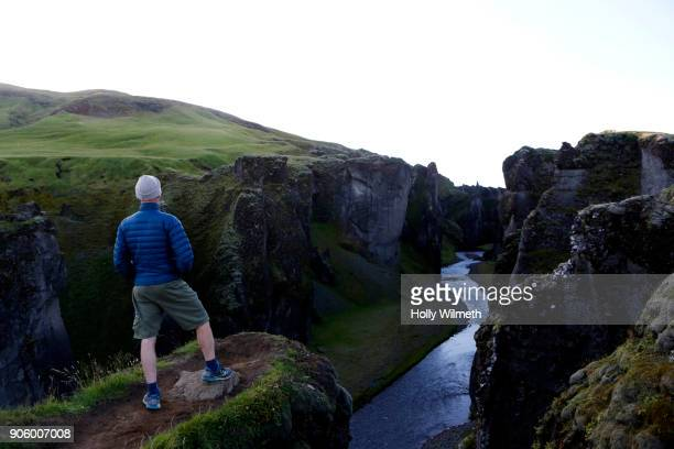 Caucasian man admiring scenic view of canyon river