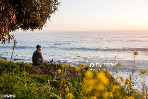caucasian man admiring scenic view of ocean at sunset - oakland california stock pictures, royalty-free photos & images