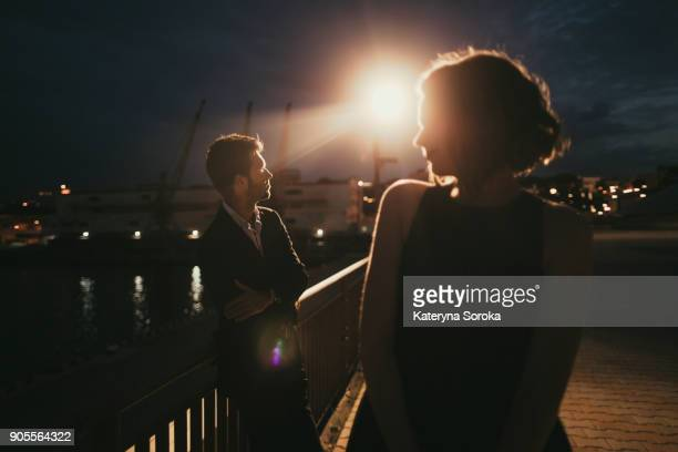 caucasian man and woman at waterfront at night - arguing photos stock pictures, royalty-free photos & images