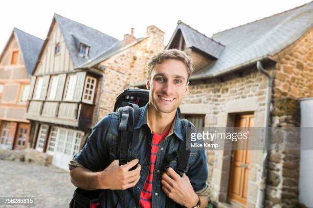 caucasian man backpacking in city - cotes d'armor stock photos and pictures