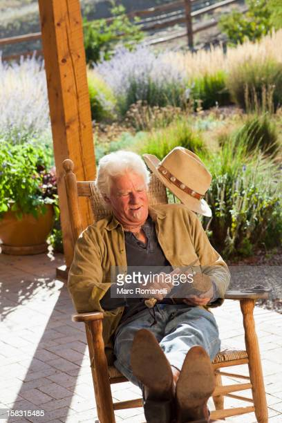 caucasian man carving wood - rocking chair stock pictures, royalty-free photos & images