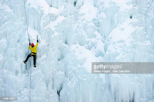 caucasian man climbing ice - struggle stock pictures, royalty-free photos & images