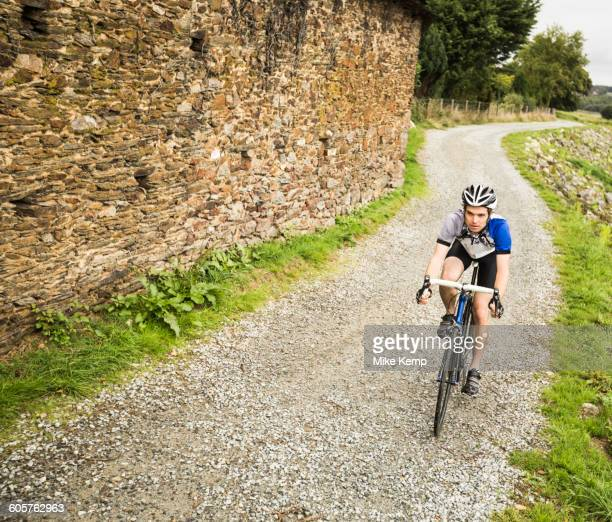 Caucasian man cycling on gravel path