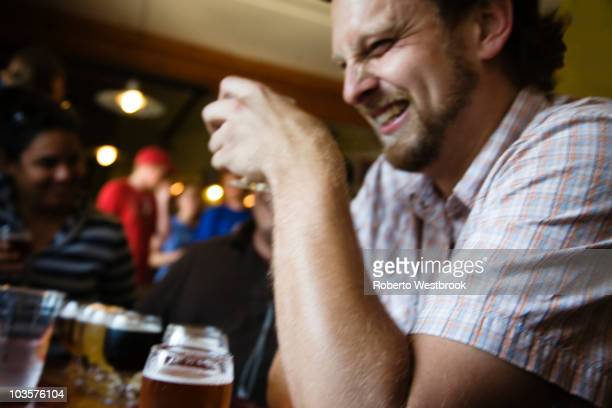 Caucasian man drinking in bar
