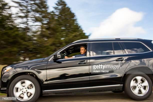 Caucasian man driving car
