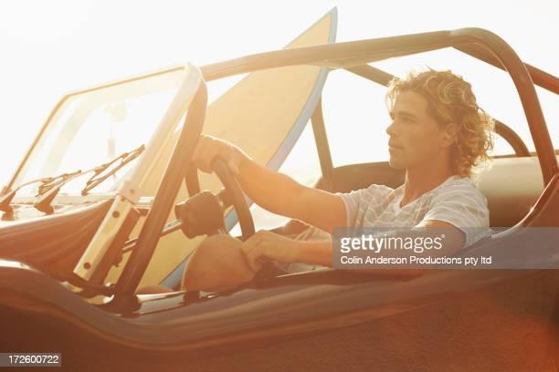 Caucasian man driving jeep