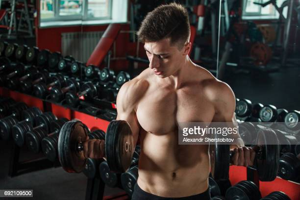 Caucasian man exercising with dumbbells