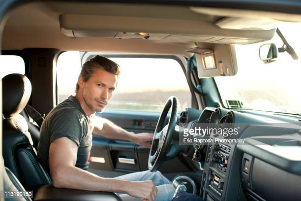 Caucasian man getting into truck
