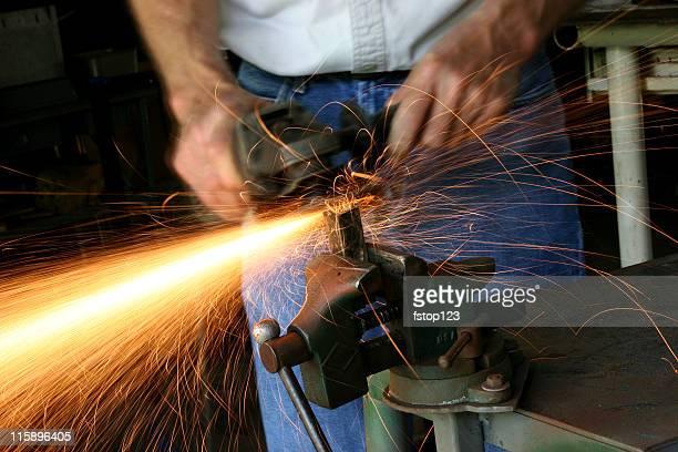 Caucasian Man Grinding in a workshop.