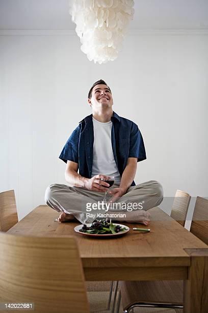 Caucasian man having dinner sitting on table