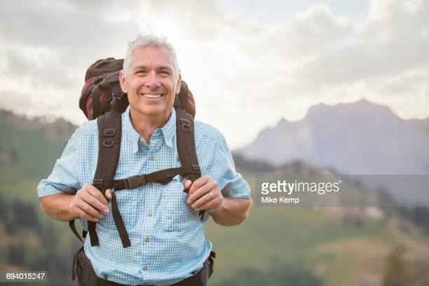 caucasian man hiking on mountain - one mature man only stock pictures, royalty-free photos & images