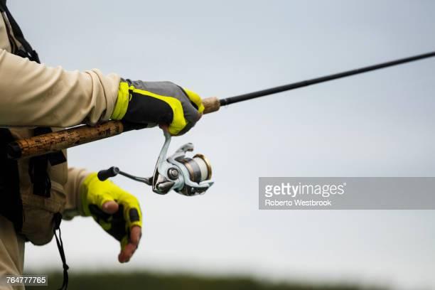 Caucasian man holding fishing rod