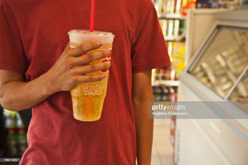 Caucasian man holding soda : Stock Photo