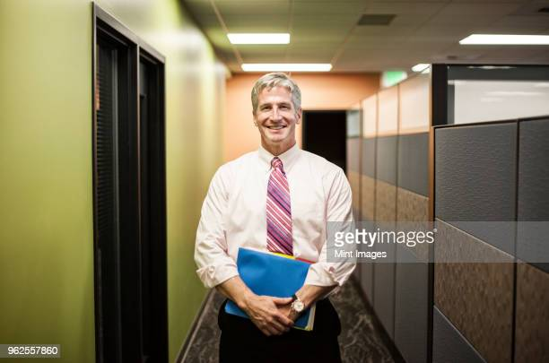 Caucasian man in an office hallway