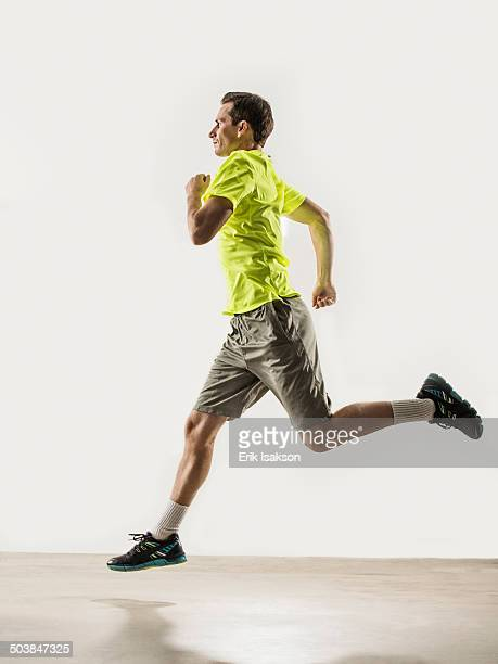 Caucasian man jogging indoors