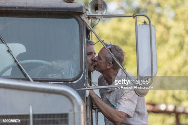 caucasian man kissing truck driver - oroville california stock pictures, royalty-free photos & images