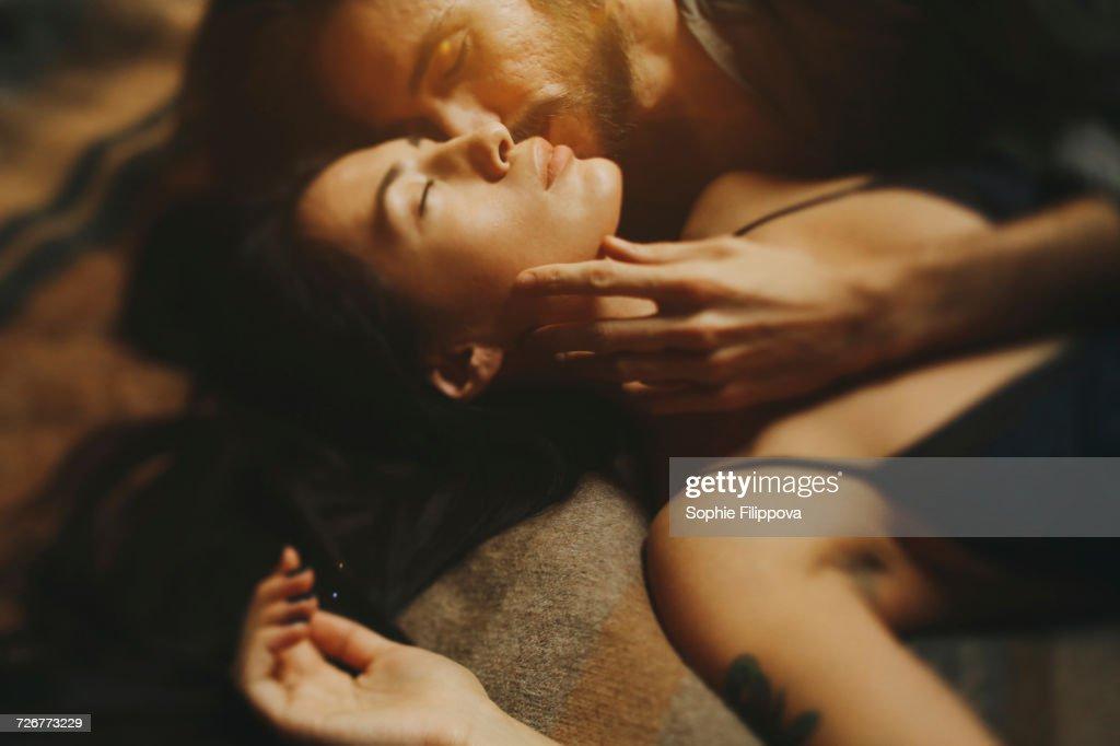 Caucasian man kissing woman on cheek : Stock Photo
