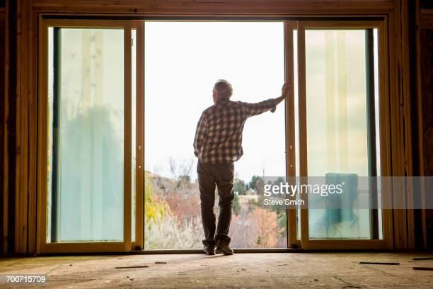 Caucasian man leaning in doorway