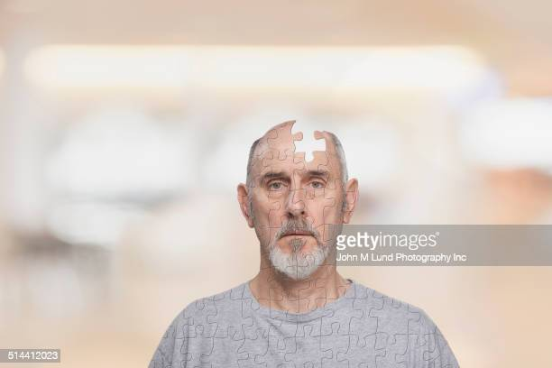 Caucasian man missing puzzle piece from head