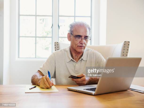 Caucasian man online shopping on laptop