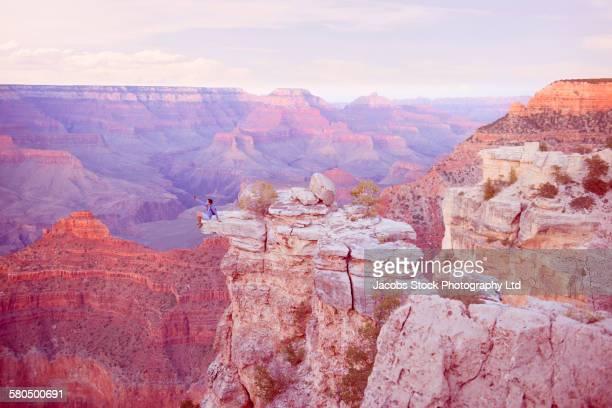Caucasian man photographing Grand Canyon, Arizona, United States