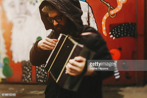 Caucasian man playing accordion