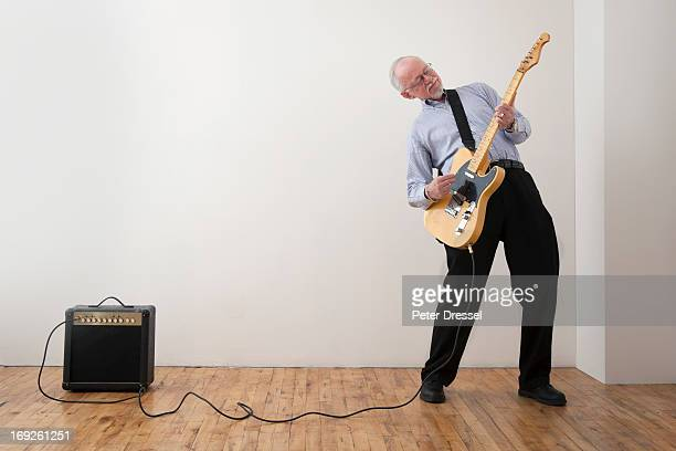Caucasian man playing electric guitar