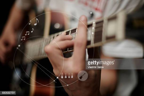 Caucasian man playing guitar overlaid with graphic design