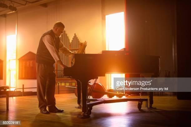 caucasian man playing piano on stage - fabolous musician stock photos and pictures