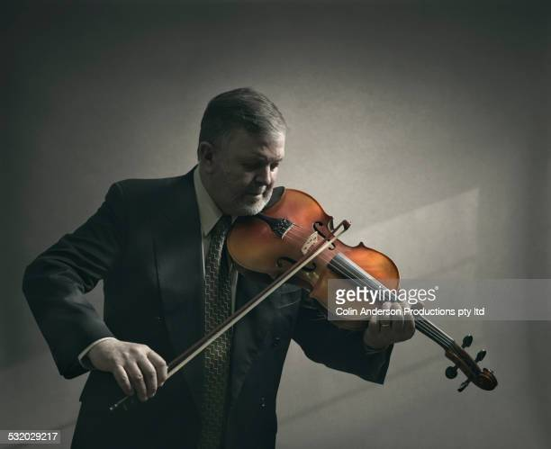 Caucasian man playing violin