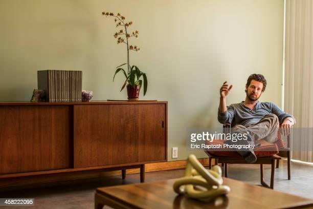Caucasian man relaxing in living room
