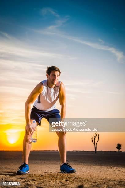Caucasian man resting in desert