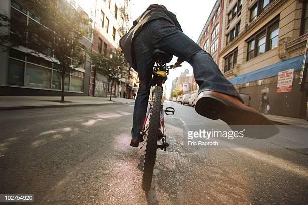 Caucasian man riding bicycle on urban street