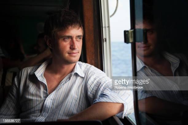 Caucasian man riding in boat