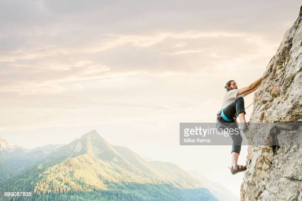caucasian man rock climbing - mountaineering stock pictures, royalty-free photos & images