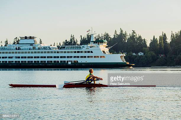 caucasian man rowing on lake near cruise ship - kitsap county washington state stock pictures, royalty-free photos & images